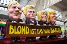 Ein Karnevalswagen zeigt am 27.02.2017 in Düsseldorf (Nordrhein-Westfalen) das Motiv «Blond ist das neue braun». Uns kritt nix klein · Narrenfreiheit, die muss sein ist das Motto des diesjährigen Rosenmontagsumzugs. Foto: Marcel Kusch/dpa +++(c) dpa - Bildfunk+++